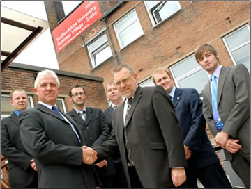 Staffordshire University Secretary Ken Sproston formalises the contract with Edwin Lewis, Director, Wider Impact Consultancy